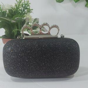 Arbonne black sparkle clutch